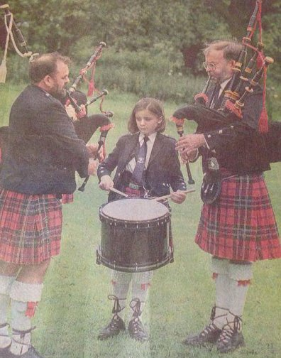 World Solo Drumming Juvenile Champion  Lee Lawson (12) practicing with Pipe Major Sam Hodgen (left) and Kenny Magowan during the North Down Champion-ships at Castle Park Bangor, N.Ireland.