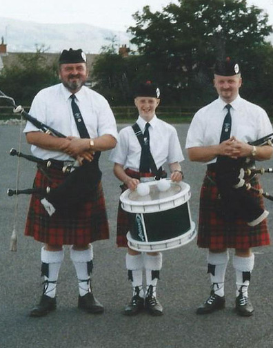Sam with his grandson William, son Nigel, three generations in Moneygore Pipe Band.